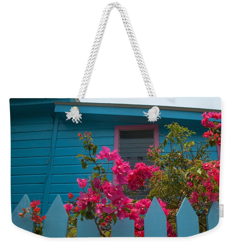 Roatan Weekender Tote Bag featuring the photograph Pink And Blue House by Susan Rovira