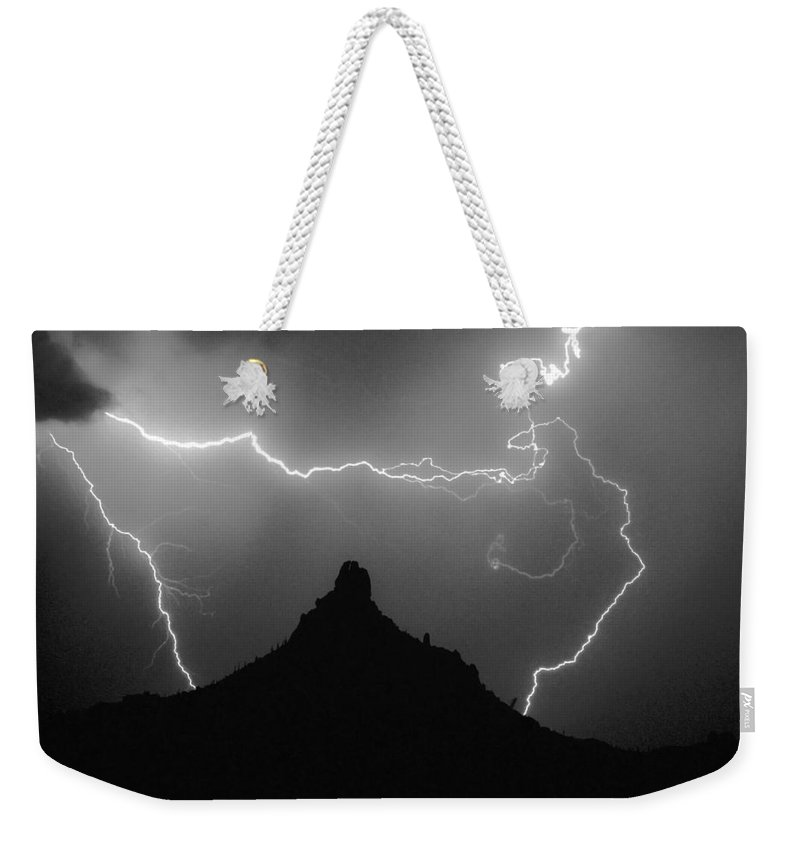 Lightning Weekender Tote Bag featuring the photograph Pinnacle Peak Surrounded by James BO Insogna