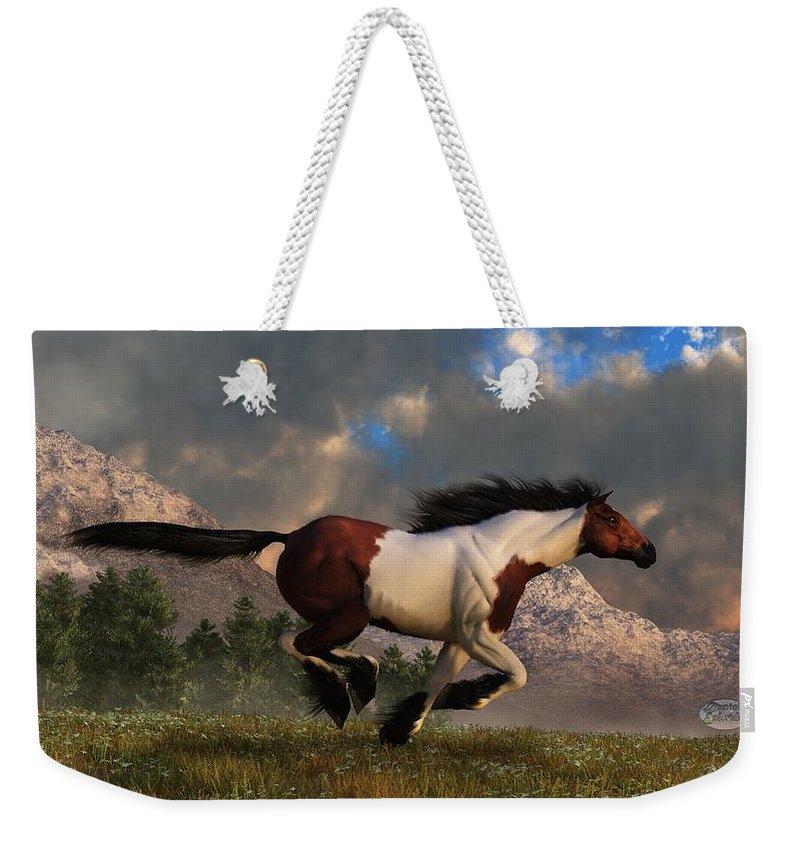 Hidalgo Weekender Tote Bag featuring the digital art Pinto Mustang Galloping by Daniel Eskridge