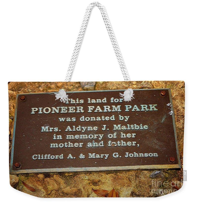 Pioneer Farm Park Weekender Tote Bag featuring the digital art Pioneer Farm Park Plaque At Andersonville Georgia by Kim Pate