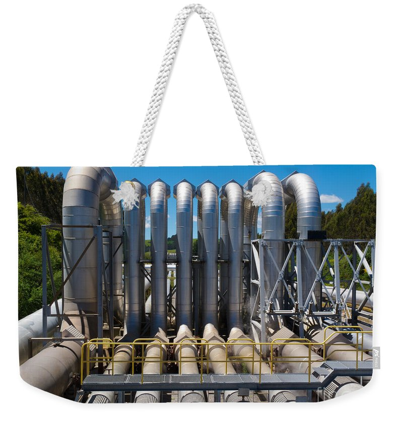 Aboveground Weekender Tote Bag featuring the photograph Pipeline Installation For Distribution And Supply by Stephan Pietzko