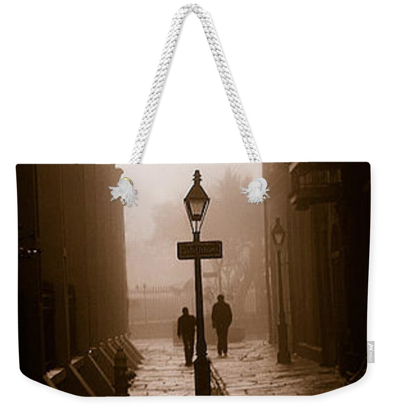 Pirate's Alley Weekender Tote Bag featuring the photograph Pirate's Alley New Orleans by Mike Nellums