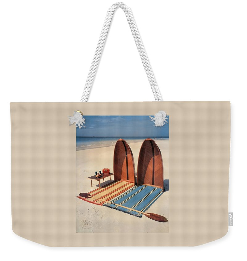 Accessories Weekender Tote Bag featuring the photograph Pixie Collapsible Boat On The Beach by Lois and Joe Steinmetz
