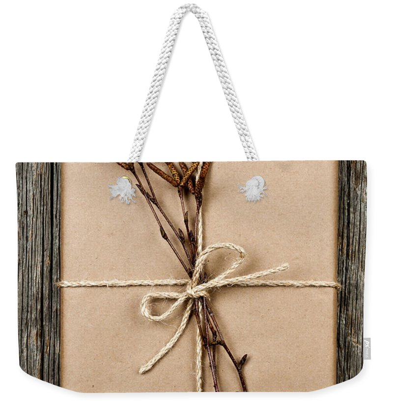 Package Weekender Tote Bag featuring the photograph Plain Gift With Natural Decorations by Elena Elisseeva