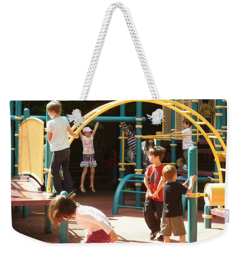 Weekender Tote Bag featuring the photograph Playground by Katerina Naumenko