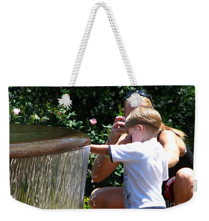 Art For The Wall...patzer Photography Weekender Tote Bag featuring the photograph Playing In Water by Greg Patzer