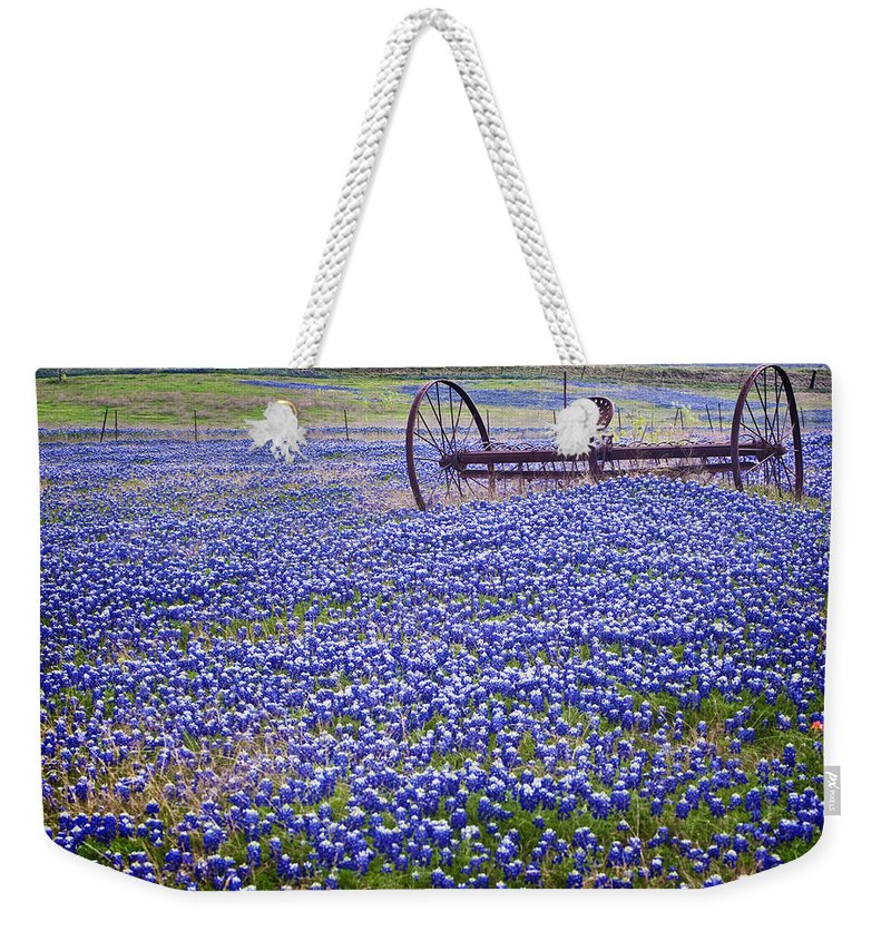 a70f93f46b Blue Weekender Tote Bag featuring the photograph Plow In The Bluebonnet  Field by David and Carol