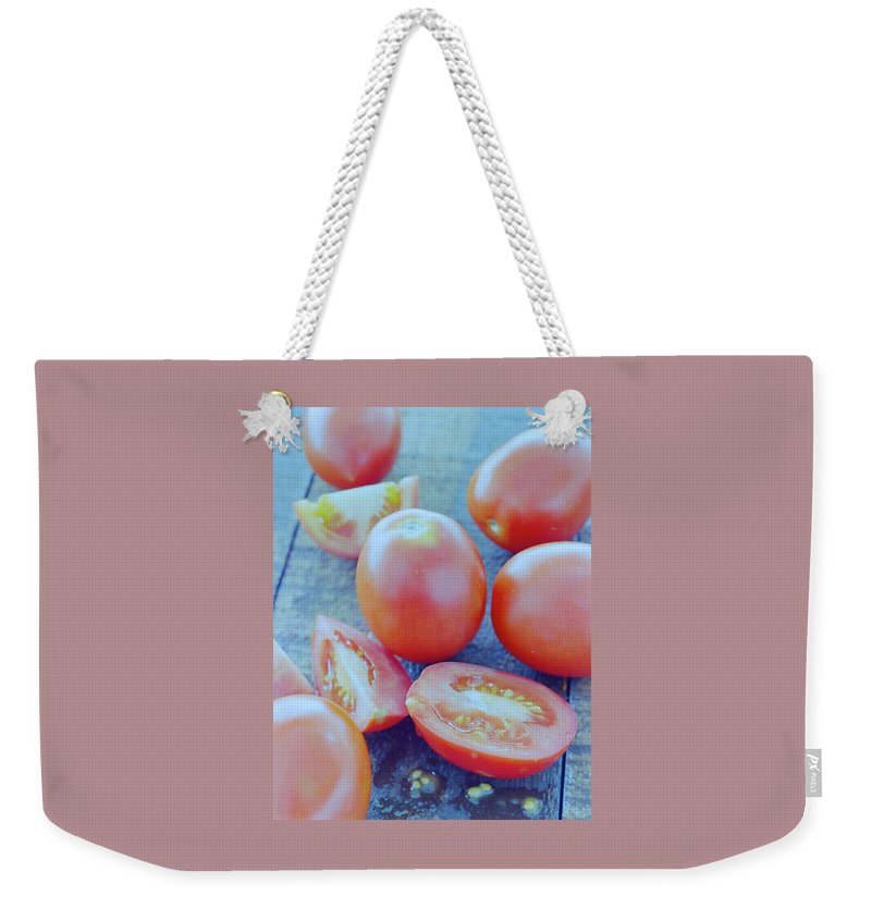 Fruits Weekender Tote Bag featuring the photograph Plum Tomatoes On A Wooden Board by Romulo Yanes