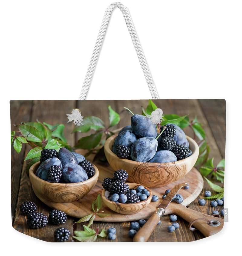 Plum Weekender Tote Bag featuring the photograph Plums And Berries by Verdina Anna