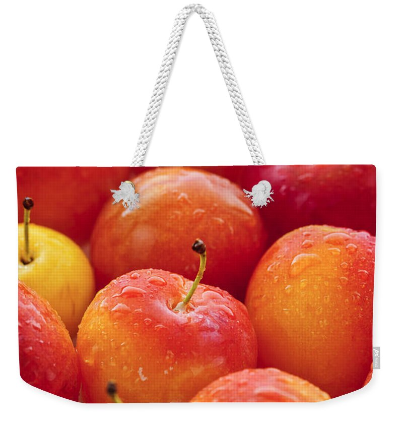 Plums Weekender Tote Bag featuring the photograph Plums by Elena Elisseeva