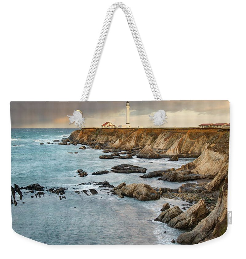 Headland Weekender Tote Bag featuring the photograph Point Arena Headland And Lighthouse by Kjschoen