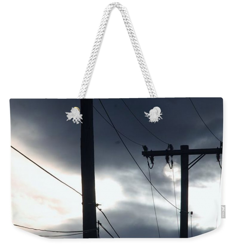 Scenic Weekender Tote Bag featuring the photograph Poles And Sunsets by Rob Hans