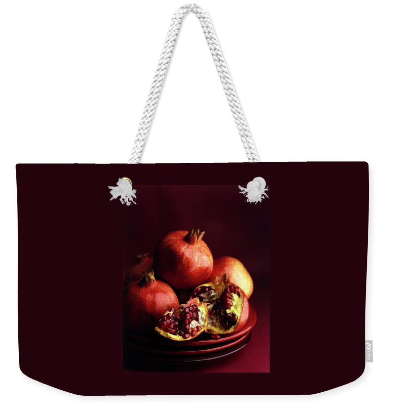 Fruits Weekender Tote Bag featuring the photograph Pomegranates by Romulo Yanes