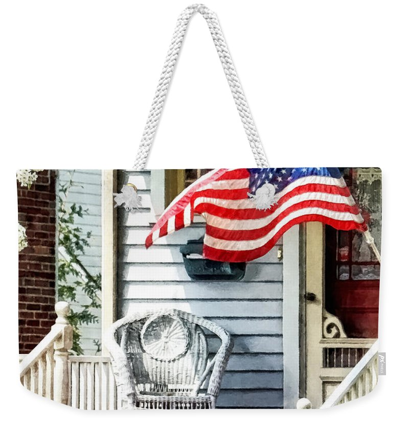 Flag Weekender Tote Bag featuring the photograph Porch With Flag And Wicker Chair by Susan Savad
