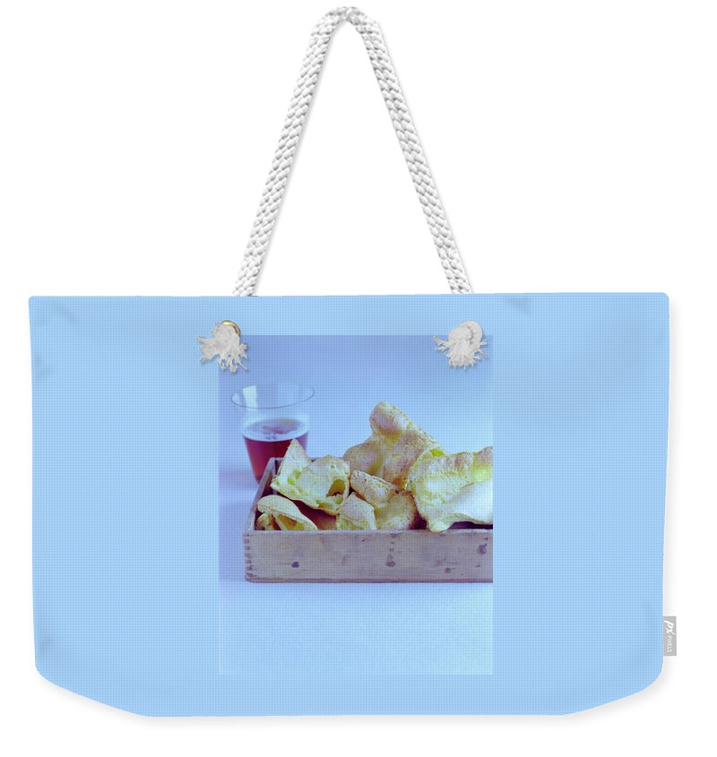 Cooking Weekender Tote Bag featuring the photograph Pork Rinds With A Pint by Romulo Yanes