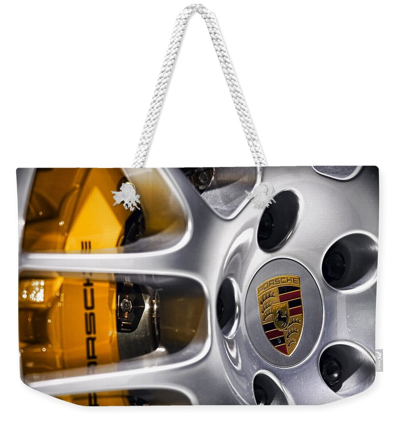 Porsche Weekender Tote Bag featuring the photograph Porsche Wheel by Gordon Dean II