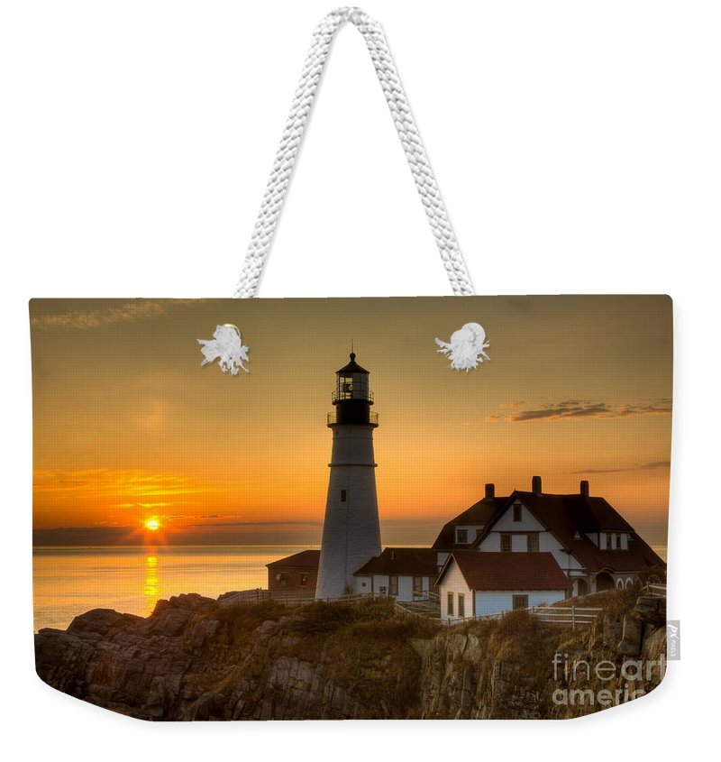 Clarence Holmes Weekender Tote Bag featuring the photograph Portland Head Light At Sunrise II by Clarence Holmes