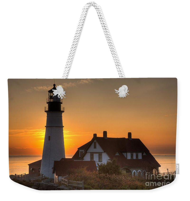 Clarence Holmes Weekender Tote Bag featuring the photograph Portland Head Light At Sunrise IIi by Clarence Holmes