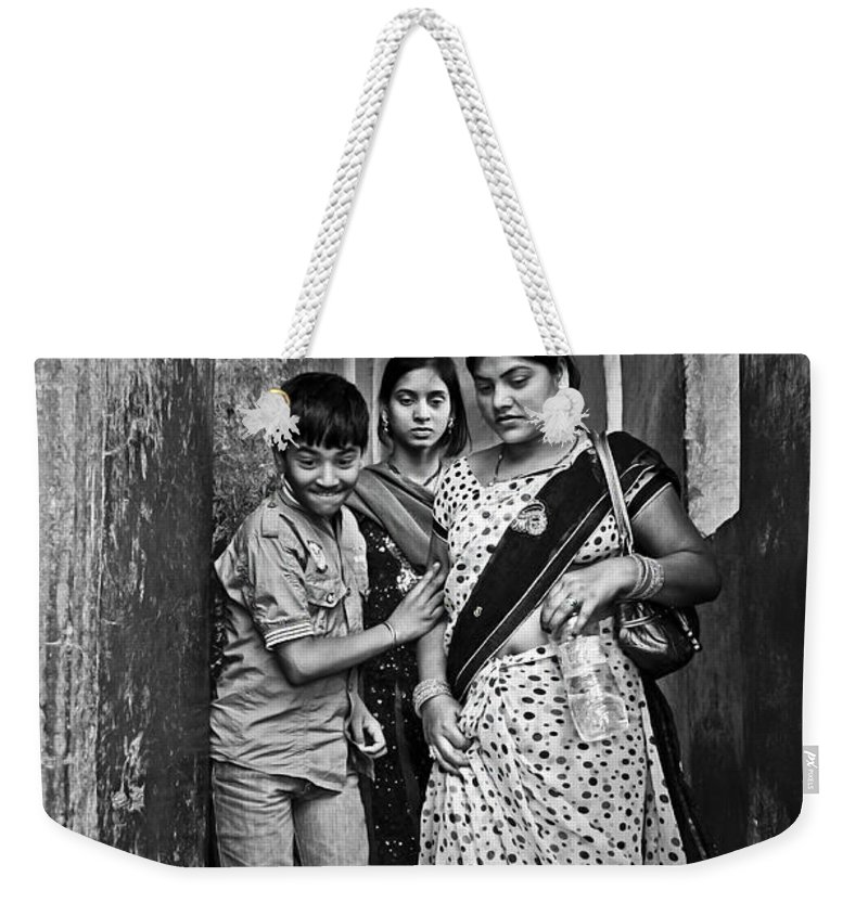 People Weekender Tote Bag featuring the photograph Portrait Of A Candid Moment by Valerie Rosen