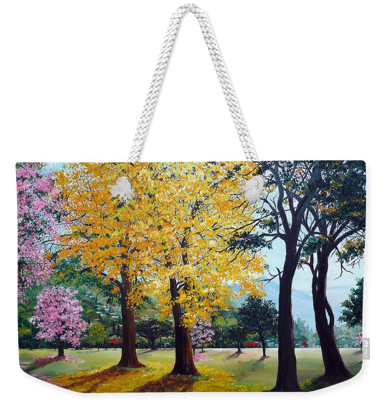 Tree Painting Landscape Painting Caribbean Painting Poui Tree Yellow Blossoms Trinidad Queens Park Savannah Port Of Spain Trinidad And Tobago Painting Savannah Tropical Painting Weekender Tote Bag featuring the painting Poui Trees in the Savannah by Karin Dawn Kelshall- Best