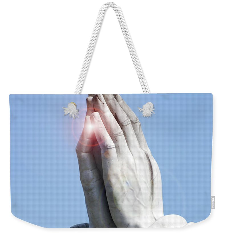 Vertical Weekender Tote Bag featuring the photograph Praying Hands Lens Flare by Sally Rockefeller