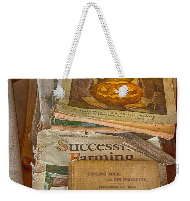 Farm Magazine Weekender Tote Bag featuring the photograph Preferred Reading Material by Jeff Folger