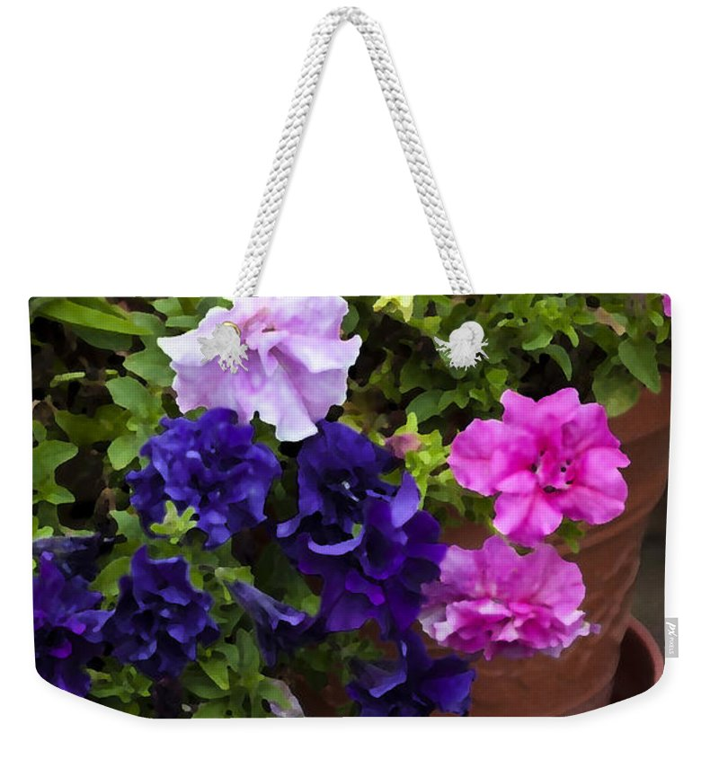 Petinias Weekender Tote Bag featuring the photograph Pretty Petunias by Rich Franco