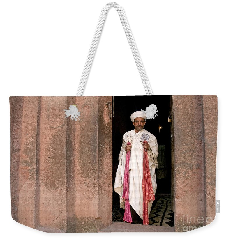 Lalibela Weekender Tote Bag featuring the photograph Priest At Ancient Rock Hewn Churches Of Lalibela Ethiopia by Jacek Malipan