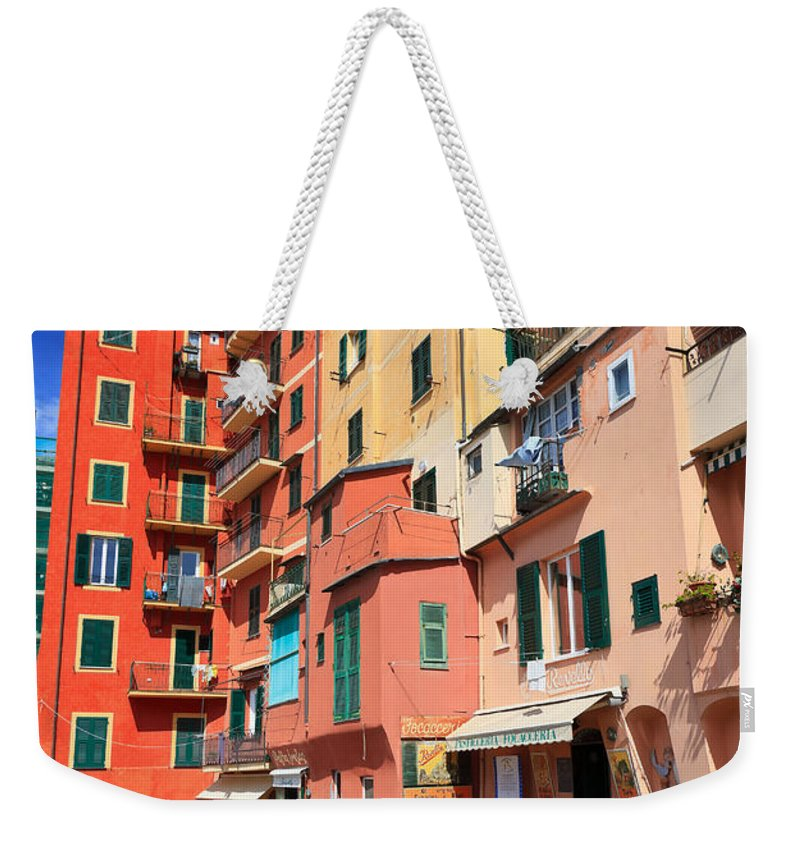 Ancient Weekender Tote Bag featuring the photograph promenade and homes in Camogli by Antonio Scarpi