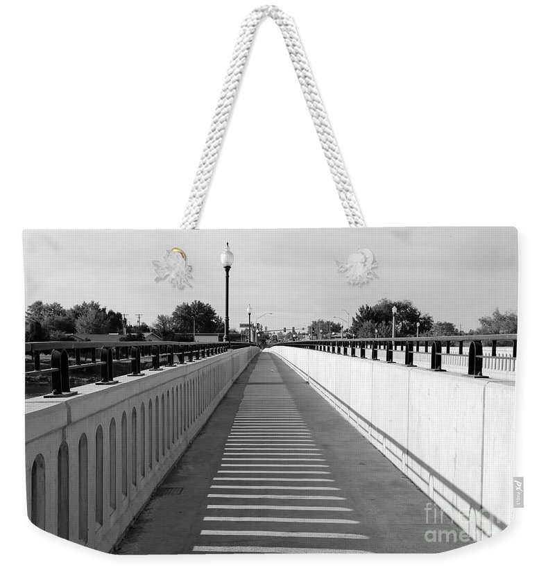 Prosser Weekender Tote Bag featuring the photograph Prosser Bridge Perspective - Black And White by Carol Groenen