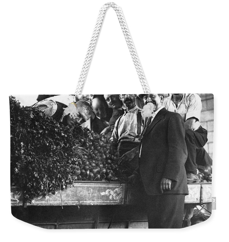 1910 Weekender Tote Bag featuring the photograph Public Market Vegetable Stand by Underwood Archives