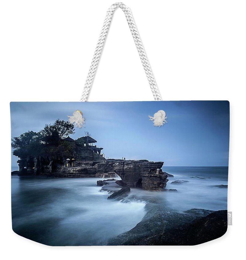 Pura Tanah Lot Weekender Tote Bag featuring the photograph Pura Tanah Lot by Franciscus Nanang Triana