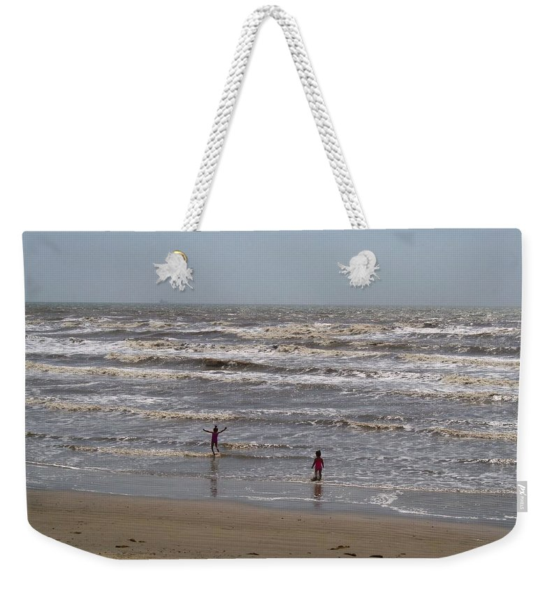 Beach Weekender Tote Bag featuring the photograph Pure Joy by Kathryn Meyer