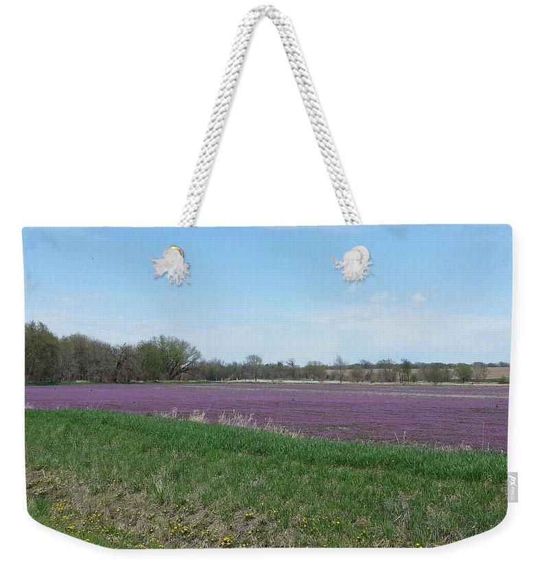 Henbit Weekender Tote Bag featuring the photograph Purple Field by Caryl J Bohn