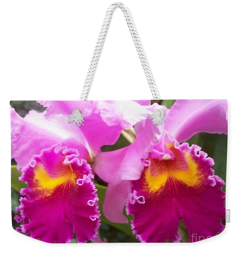 Floral Weekender Tote Bag featuring the photograph Purple Orchids by Eric Schiabor