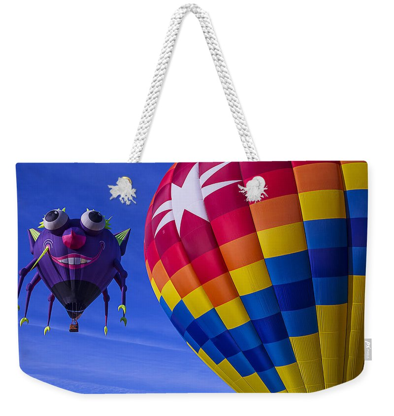 Purple People Eater Weekender Tote Bag featuring the photograph Purple People Eater Rides The Wind by Garry Gay