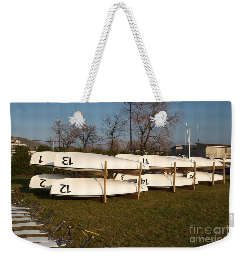 420s Weekender Tote Bag featuring the photograph Putting The Toys Away by William Norton