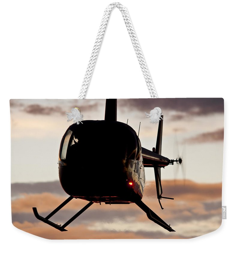 Robinson's R44 Raven 2 Weekender Tote Bag featuring the photograph R44 At Sunset by Paul Job