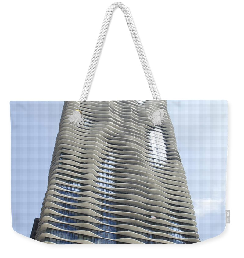 Chicago Weekender Tote Bag featuring the photograph Radisson Blu Facade Vertical by Thomas Woolworth