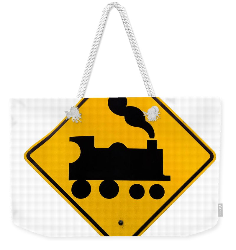Attention Weekender Tote Bag featuring the photograph Railroad Crossing Steam Engine Roadsign On White by Stephan Pietzko