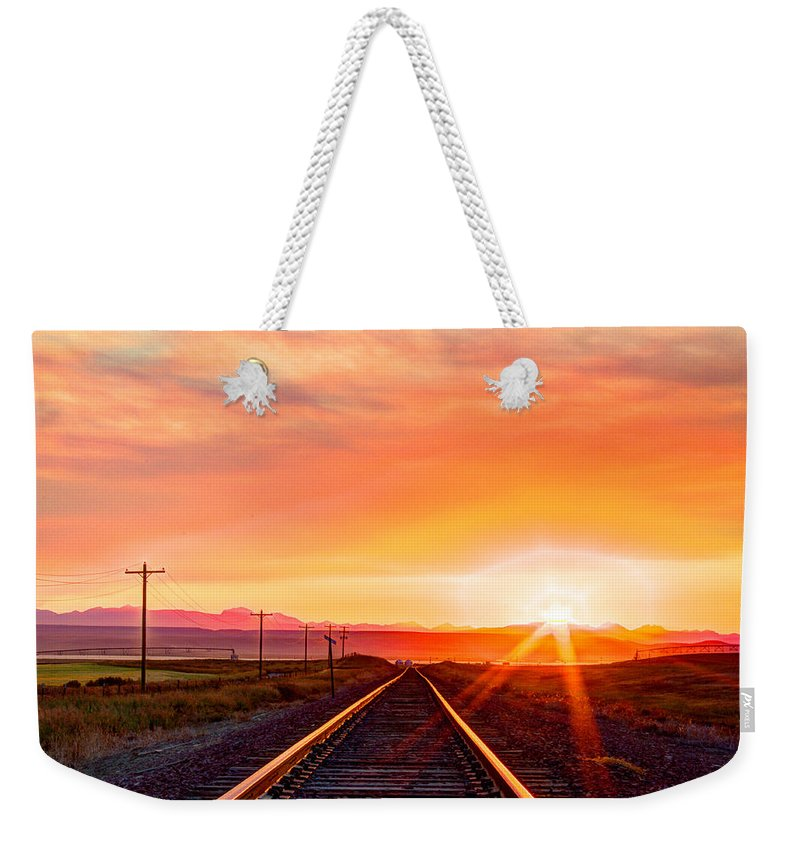 Landscape Weekender Tote Bag featuring the photograph Rails To The Red Sky by John Lee