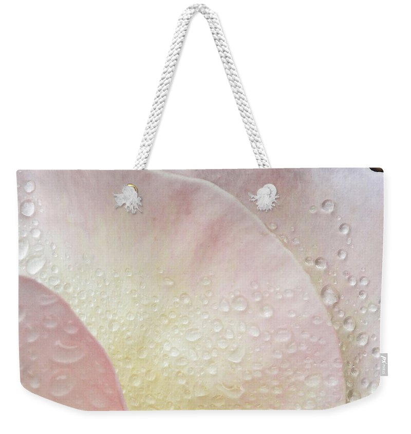 Petals Weekender Tote Bag featuring the photograph Rain Shields Deployed Captain by Steve Taylor