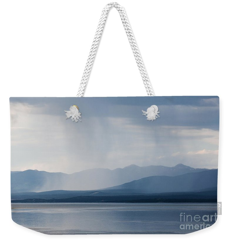 Atmosphere Weekender Tote Bag featuring the photograph Rain Shower Over Marsh Lake Yukon Territory Canda by Stephan Pietzko