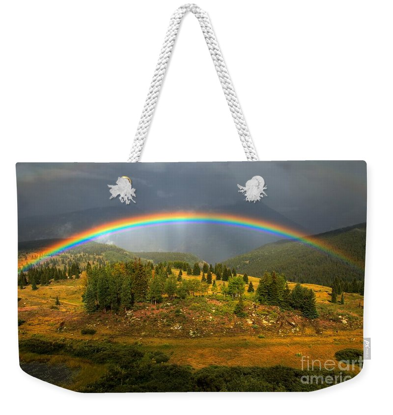 San Juan Mountains Weekender Tote Bag featuring the photograph Rainbow Through The Forest by Adam Jewell