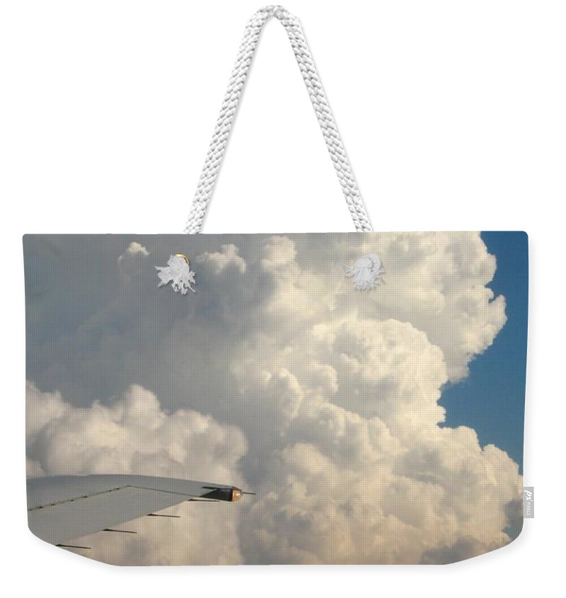 Weather Weekender Tote Bag featuring the photograph Rainmaker by Ann Horn