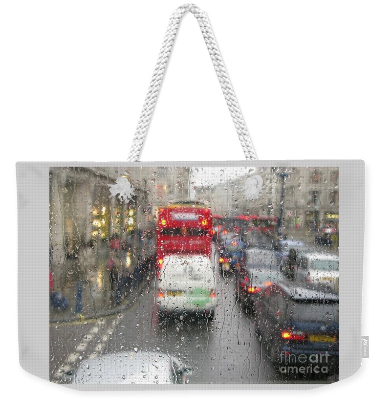 Rainy Day London Traffic By Ann Horn Weekender Tote Bag featuring the photograph Rainy Day London Traffic by Ann Horn