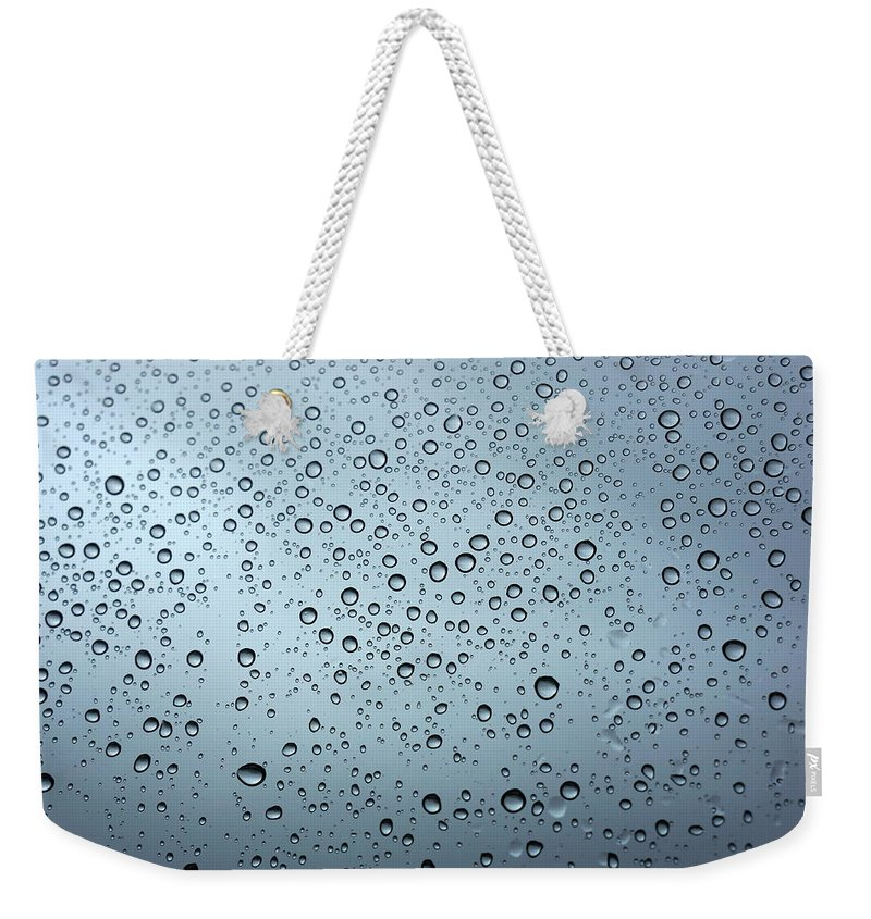 Horizontal Weekender Tote Bag featuring the photograph Rainy Day Out by Nigel Killeen