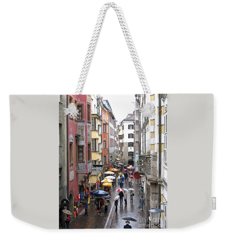 Innsbruck Weekender Tote Bag featuring the photograph Rainy Day Shopping by Ann Horn