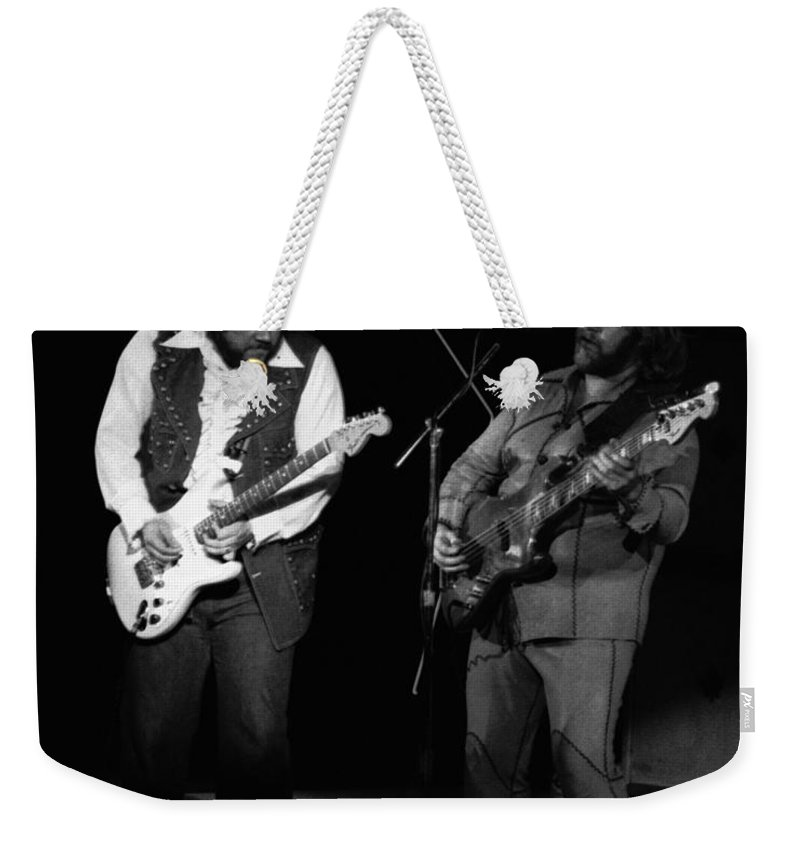 Bachman-turner Overdrive Weekender Tote Bag featuring the photograph Randy And C.f. Rockin Out In Spokane In 1976 by Ben Upham