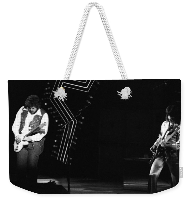 Bachman-turner Overdrive Weekender Tote Bag featuring the photograph Randy And Blair 1976 by Ben Upham